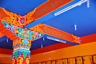 Photo: Detailed wood carving art, calligraphy art and amazing color painting of the interior catch visitors' eyes at the Sowa Rigpa Medical Institute.
