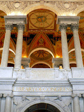 Photo: Entrance to the main reading room. Below the gilded lettering, LIBRARY OF CONGRESS, are two figures reading and leaning on the arch over the doorway. Juventus on the left; Senex on the right: symbols of life-long learning.