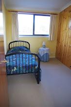 Photo: Single bedroom upstairs