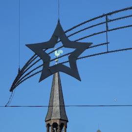 The cock on a spire through a star by Svetlana Saenkova - Buildings & Architecture Architectural Detail ( blue sky, star, spire, tip, cock )
