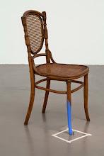 Photo: Sin título (Hombre pintando la silla) 2015 Silla de madera, figurín, acrílico azul, cinta adhesiva de papel. 92 x 41 x 50 cm