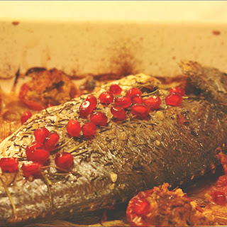 Gilt-head bream in the oven with Stuffed Tomatoes and Pomegranate.