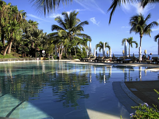 Living the dream: The pool at the refurbished Grand Gaube on the north coast of Mauritius is surrounded by trees and the sea. Lesley Stones