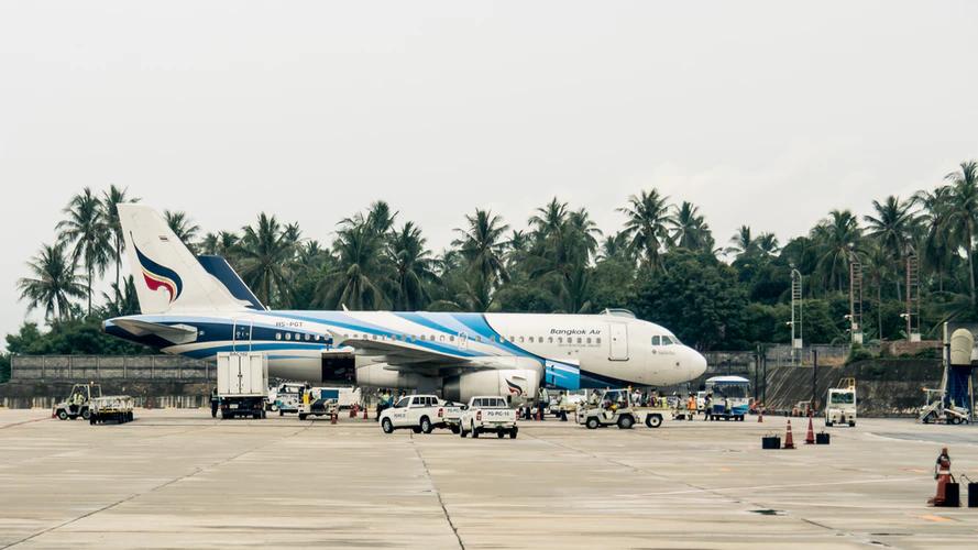 A Bangkok Air airplane at the airport, ready to take passengers on a short ride from Bangkok to Koh Samui.