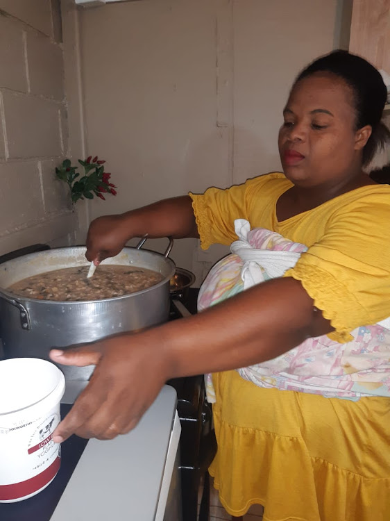 Brenda Adkins preparing food for her feeding scheme for children and the elderly