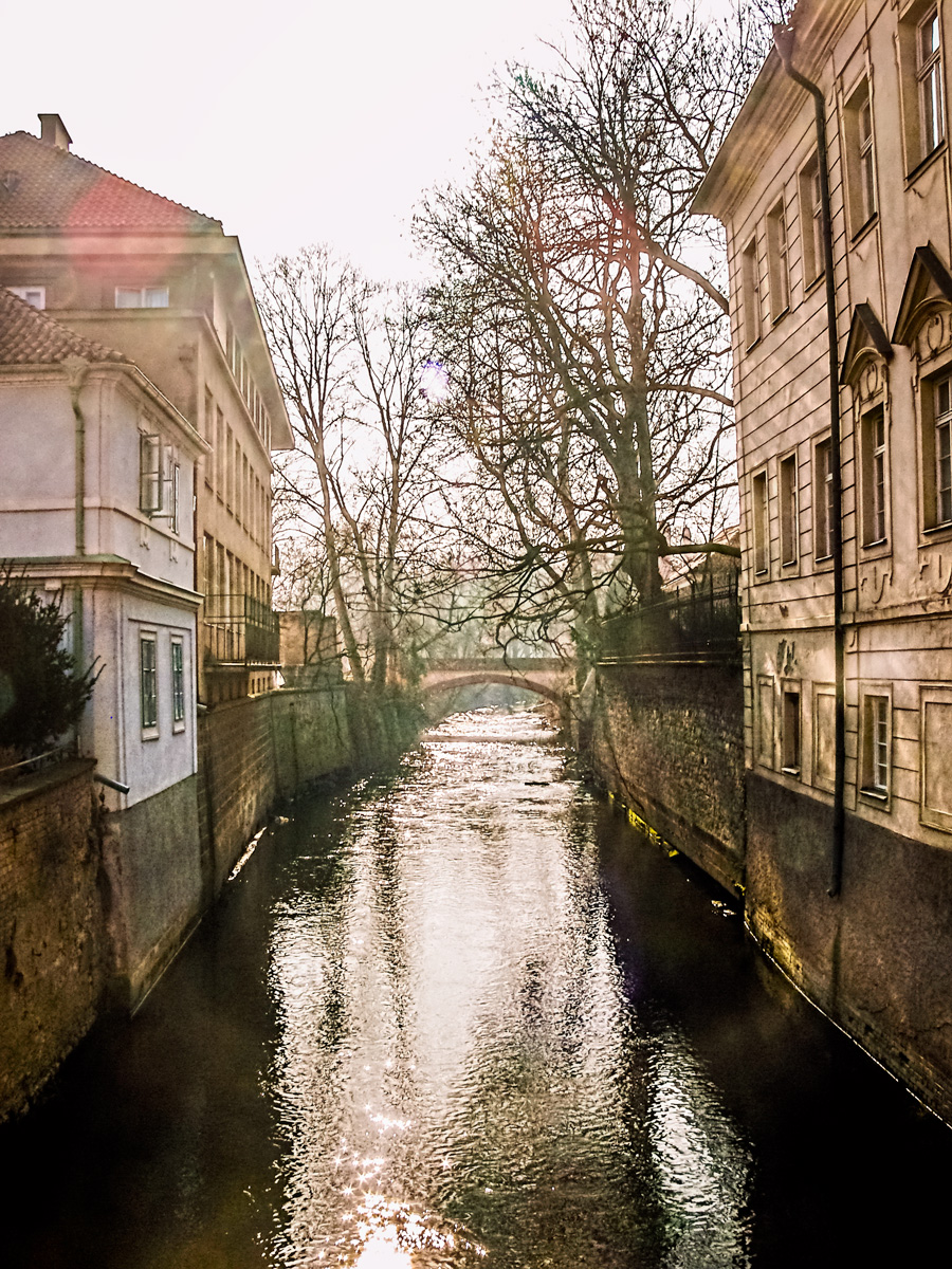 Photo: Little Venice, Prague --  Shooting into the sun. A bridge crosses one of the canals off of the Vltava.