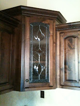 Photo: Kitchen cabinet door with traditional stained glass. Leaded glass, kitchen, curio, pantry, armoire, butler's pantry. Custom handmade beautiful glass.
