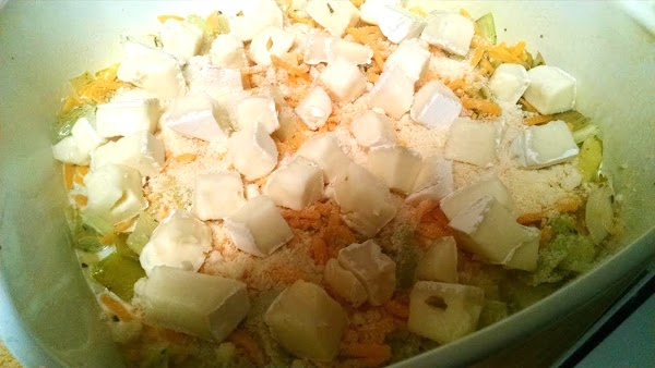 Add salt and pepper to taste. Transfer mixture into a baking dish. Stir in...