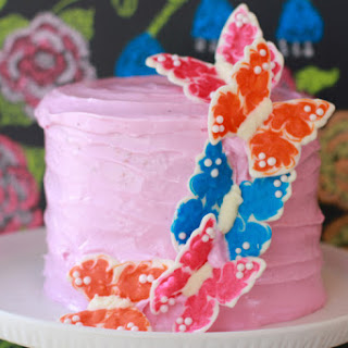 White Velvet Cake w/Strawberry Buttercream Frosting and Chocolate Butterflies