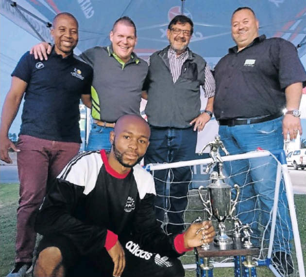 Young Ideas player Thando Oyisi (front) hopes to retain the Caltex Greenbushes Fresh Stop Youth Day soccer tournament title next week. With him are (back, from left) Kuyga LFA member Xola Peter, Robert Engelbrecht, of Fresh Stop, and Jurie Snyman and Dewald Niemand, from Caltex Greenbushes
