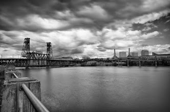 Photo: Steel Bridge Portland, OR. 2012.  During a photowalk in Portland a few months back, we were fortunate enough to get an afternoon shower. 15 second exposure done with the aid of my 10-stop Lee big stopper.  I was surprised to find that the group had moved on by the time I finished this shot, and I almost missed the group photo.