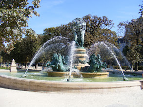 Photo: At the southern end of this chestnut-tree-lined garden is this monumental fountain, known variously as the Fontaine des Quatre Parties du Monde (Fountain of the Four Parts of the World), the Fontaine de l'Observatoire or the Fontaine Carpeaux, after the main sculptor. Built in 1873 under the supervision of Gabriel Davioud, the bronze masterpiece represents Asia (depicted by the figure of a Chinese woman), Africa (represented by the figure of a black woman), Europe (represented by the figure of a white woman), and America (depicted by the female figure of an American Indian). The four figures, which support a globe decorated with zodiac signs, are surrounded by prancing sea horses, created by Emmanuel Frémiet. Finally, smaller statues of fish and turtles ring the outer edge of the fountain.
