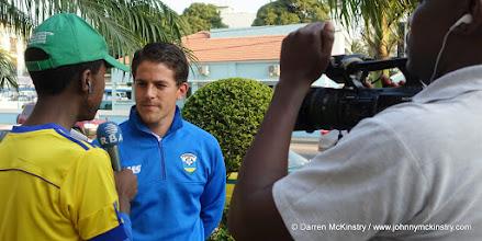 Photo: Coach McKinstry speaks to local media upon arrival in Maputo, Mozambique  [Training camp ahead of Rwanda Amavubi v Mozambique on 14 June 2015 (Pic © Darren McKinstry / www.johnnymckinstry.com)]