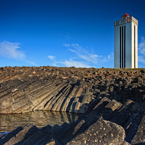 Lighthouses in Iceland by Þorsteinn Ásgeirsson - Buildings & Architecture Bridges & Suspended Structures ( water, lava, lighthouse, sea, stones, basalt )