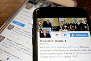 The  US President Donald Trump  tweets an average of 11 or 12 times a day./  Andrew Harrer/Bloomberg/Getty Images