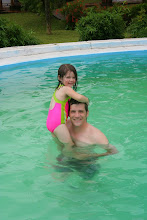 Photo: We had a few new swimming adventures, like Lydia learning to stand on Daddy's hands and Addi jumping off them!