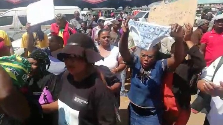 Community of Vlakfontein outside the Lenasia Magistrate's Court where two suspects linked with the killing of seven family members are appearing.