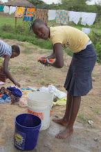 Photo: Jesca washing clothes