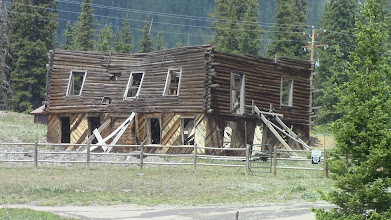 Photo: Propping up the past.  Stabalization efforts are sometimes pretty simple.  Abandoned about 1948 the community was settled about 1870.
