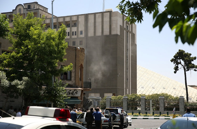 Smoke rises near the parliament's building in central Tehran, Iran, on Wednesday. Picture: TIMA/REUTERS