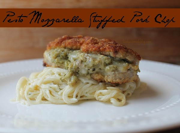 For complete recipe please visit original post: http://foodyschmoodyblog.com/pesto-mozzarella-stuffed-pork-chops/