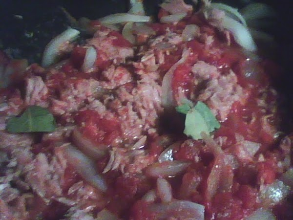 To the onions add the can of tomatoes, the pepper, garlic salt and the...