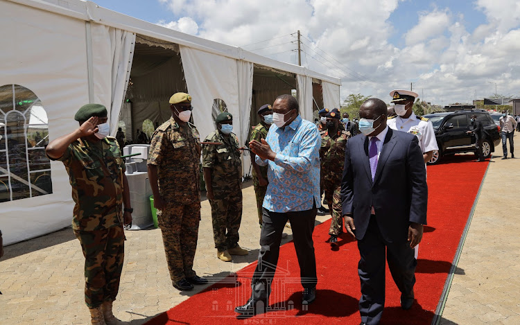 President Uhuru Kenyatta with the Interior CS Fred Matiang'i in Ruiru./PSCU