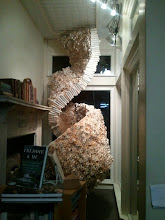 Photo: a beehive honeycomb made of rolled up book pages