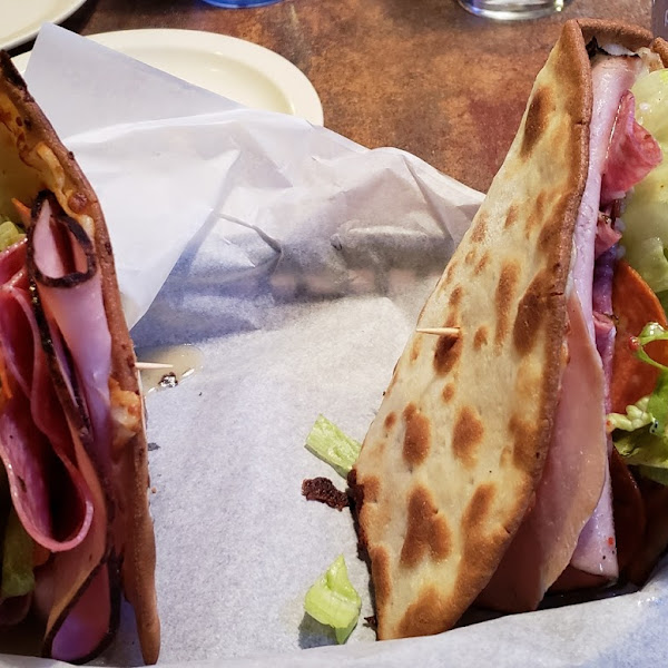Delicious Italian cold cut flatbread. Served with a side salad.