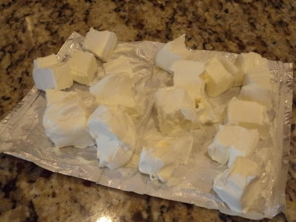 Open up the cream cheese, and cut into 16 evenly sized cubes.