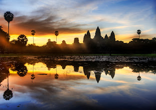 Photo: Sunrise Discovery of Angkor Wat  I feel a bit like a British explorer, surrounded by my cadre of Cambodians at $18 a day.  They drive me around, carry my tripod, bring me water when I am thirsty, and seem anxious for me to colonize the area.  A member of my cadre woke me up early this morning at 5 AM.   from the blog at www.stuckincustoms.com