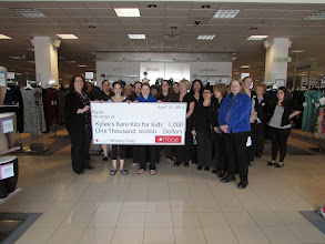 Photo: Macy's Employees and Kylee receiving the $1000 grant