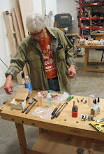 "Photo: Bob transitions to gluing the roughed up tubes into the halved blanks.  Both 5-minute epoxy and ""medium"" CA glue can be used."