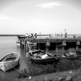 Odd Vessel Out by Naveed Dadan - Transportation Boats ( black and white, art, street, india, travel, people, portrait, man, photography, city )