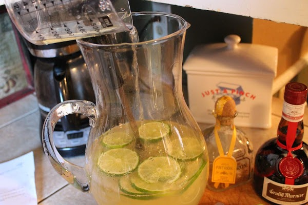 Mix the water and limeade in a clear pitcher. Add the sliced limes tequila...