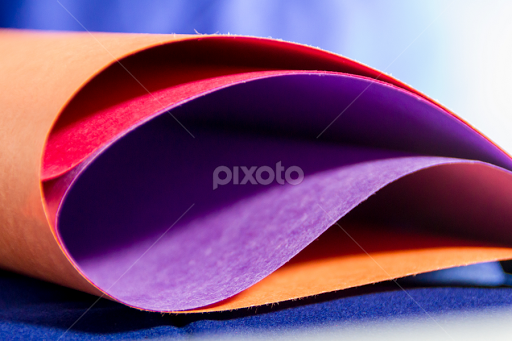 Close-up of multi colored paper with blue background | Education