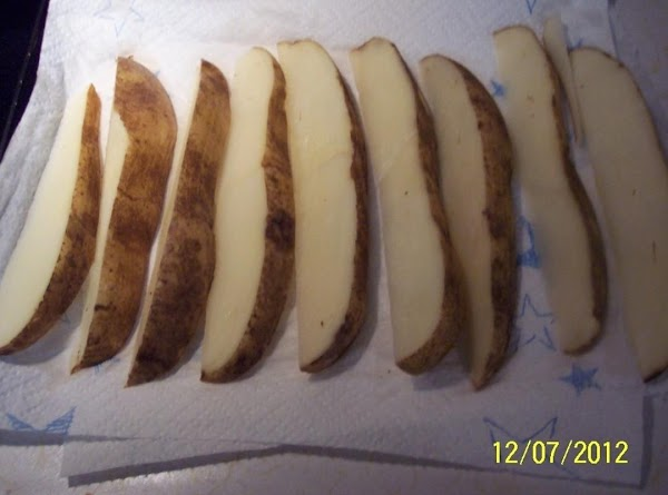 Wash and scrub a baking potato.DO not peel.Cut length wise in half.Then cut in...
