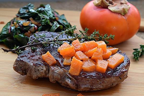 Filet Of Beef Steaks Are Pan Seared, Then Finished In The Over With Butter And Herbs.  They Are Served Alongside Swiss Chard In A Lovely Pan Sauce, And A Sweet And Tangy Persimmon Compote.  It's A Meal For Sweethearts.