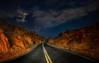 Photo: Driving Through the Valley of Fire at Night  I've left Vegas to begin a week of exploring the desert and canyonlands before yet another week in the desert at Burning Man. I'm so excited... I've got all my cameras ready (all Sony this time), and loaded for bear. I was watching +Vic Gundotralast week on his trip through the desert, and I think I'm going to all the same places... it's my first time through this area of the desert... I never made it out here for some reason when I actually lived in the US! But, no matter... better late than never. :)  This place is in the middle of the Valley of Fire, which is just about two hours outside of Las Vegas on the way to Utah...