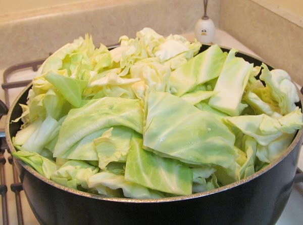 Add the cabbage. Pack it down if you need to and put the lid on.