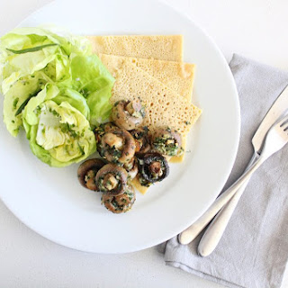 Plant-based 'Escargot' with Butter Lettuce Salad and Chickpea Pancakes.
