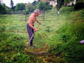 Photo: Haymaking is hard work, especially because the locals still use the scythe.