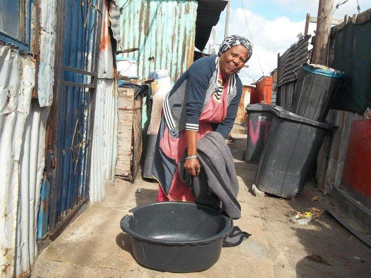 Nomishini Mone said she put big dishes and a washing basin on her bed to catch leaks throughout Thursday morning.