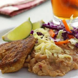 Golden Chicken with Spicy Refried Beans.