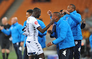 Bidvest Wits attacker Deon Hotto celebrates with teammates after scoring a goal during an Absa Premiership match against Kaizer Chiefs at FNB Stadium on Tuesday August 7 2018. Wits won 3-1.
