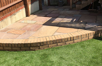 a patio made with bricks in a garden