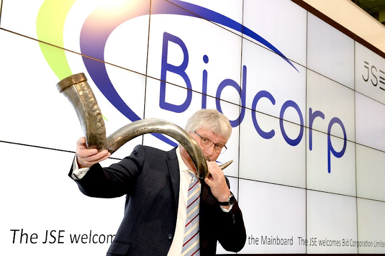 Bidcorp CEO Bernard Berson blows the traditional horn after his company listed on the JSE. Picture: RICHARD STREVER/ ZOOM PHOTOGRAPHY