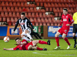 Photo: Dunfermline Athletic v Raith Rovers Irn Bru First Division East End Park 2 January 2013Joe Cardle is fouled by Dougie Hill(c) Craig Brown | StockPix.eu