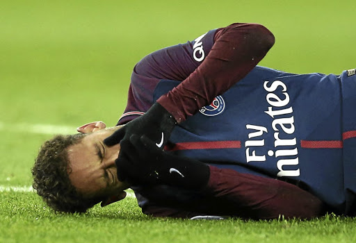 Painful feat: Neymar lies on the pitch after sustaining a broken bone in his foot last Sunday. Picture: REUTERS