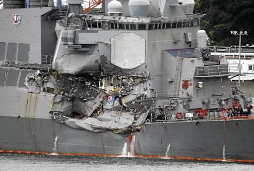 The Arleigh Burke-class guided-missile destroyer USS Fitzgerald, damaged by colliding with a Philippines-flagged merchant vessel, is seen at the US naval base in Yokosuka, Japan, on June 18 2017. Picture: REUTERS